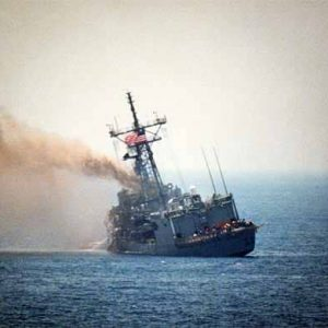 A port quarter view of the guided missile frigate USS STARK (FFG-31) listing to port after being struck by an Iraqi-launched Exocet missile.